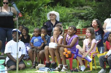Children react to a performer at the Best of Weston Multicultural Festival Saturday at the Little Avenue Memorial Park.