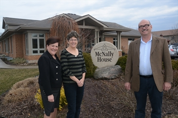 McNally House executive director Pamela Blackwood, medical director Dr. Denise Marshall and board member Murray Bain stand in front of the hospice, which marks its 10th anniversary this week.
