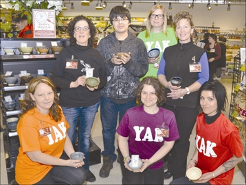 Community - On Saturday, April 5, dozens of people paid a visit to Foodsmiths in Perth to participate in the annual Empty Bowls fundraiser. Participants were able to purchase handcrafted pottery bowls for $20 and then fill them with their choice of hot soup. The money raised from the fundraiser will benefit four local organizations: the Youth Action Kommittee, Food for Thought, Table Community Food Centre and MERA Pottery Group Studio. The Empty Bowls fundraiser raises an average of $10,000 each year for local groups. Above, a few representatives from the four local groups pose for a photo, holding the handcrafted bowls. From left: Tanis Cowan, Joni Seligman, AJ Gunner, Donna Stratton, Kim Angell, Claire Smith, Kat Watson. Left, bowls were provided by MERA, after the fundraiser's veteran potter, Jackie Seaton, passed away in October. His wife, Joni Seligman, said that this year's Empty Bowls fundraiser is a special one for her, because potters from all around the country have been sending their own handcrafted bowls to the River Guild in his honour.