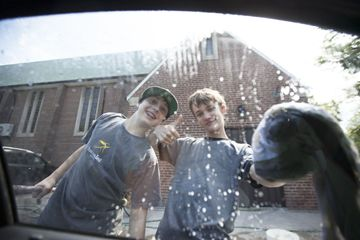 Scouts Michael Ford, left, and Taylor Colman admire their work during the 132nd Toronto Scout Troop's fundraising car wash held Saturday at Leaside Presbyterian Church. Proceeds from the event will benefit the troop's trip to the Canadian Jamboree at Sylvan Lake, Alberta July 6-13.