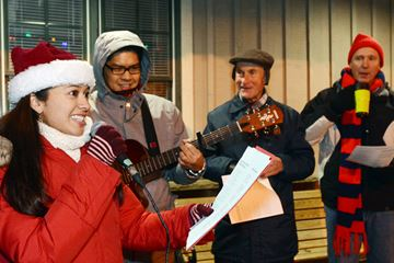 Stouffville carollers lead by Michelle and Michael Dizan, Eldon Fretz and Doug Johnson.