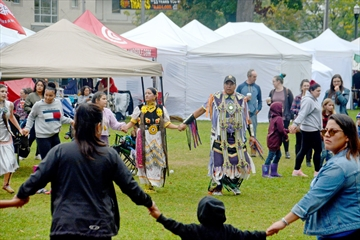 "Head dancers Rob and Elyne Issacs help lead a round dance during the Niagara Regional Native Centre's ""Nurturing Our Roots"" traditional pow wow Saturday at Montebello Park. It's the second year the event, which took place Oct. 6 and 7, was held at the downtown St. Catharines park."