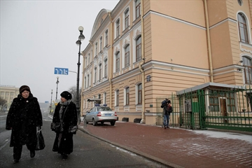 People walk passed the British Consulate General, in St. Petersburg, Russia, Saturday. Russia on Saturday announced it is expelling 23 British diplomats and threatened further measures in retaliation in a growing diplomatic dispute over a nerve agent attack on a former spy in Britain.