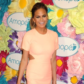Chrissy Teigen excited for morning sickness-Image1