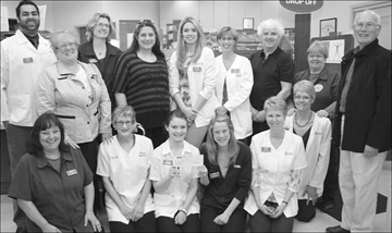 Staffmembers at the Stittsville IDA Pharmacy who are donating $1,726 to the Stittsville Food Bank as a result of a employee payroll matching program that sees the funds donated by staffmembers matched by the ownership are, front row, kneeling, from left, Lorraine Filoso, Olga Gervais, Maryann MacGregor, Catherine Miller, Shelley Dube and Jane Ledas