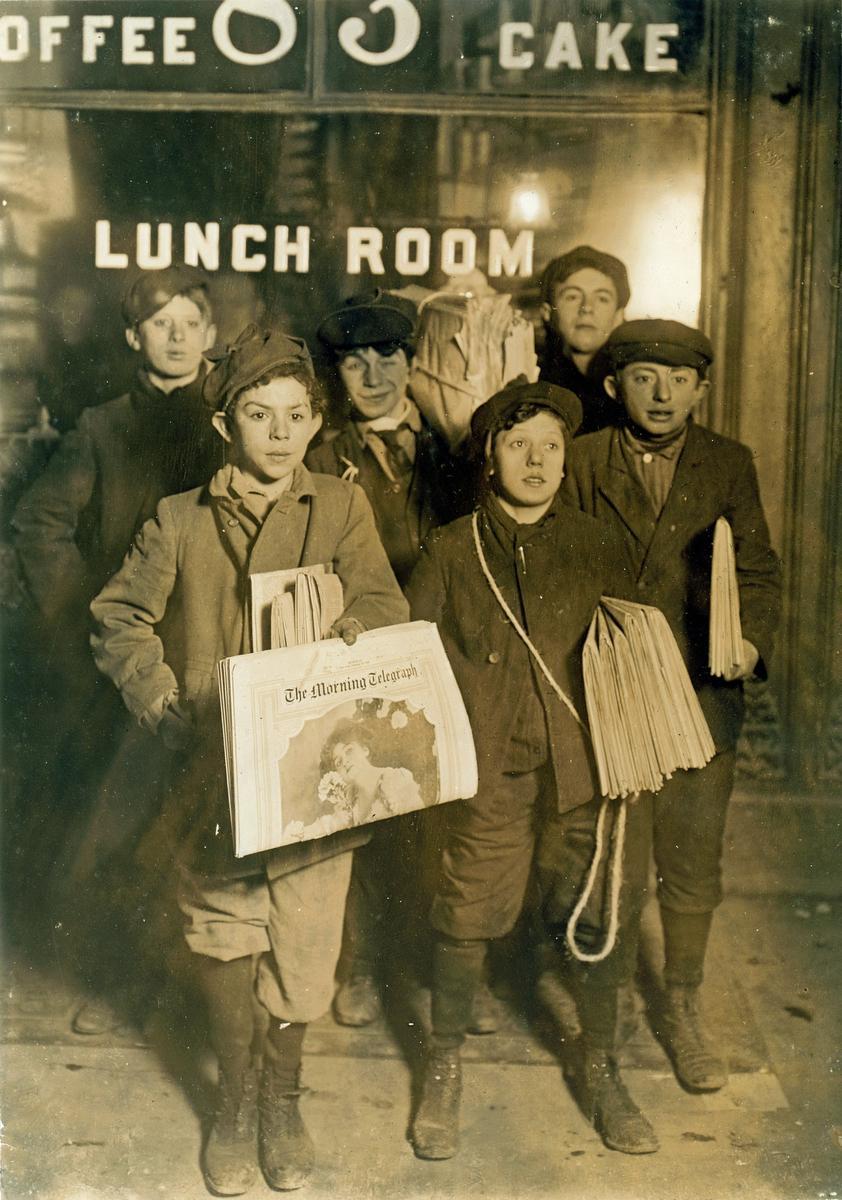 Newsboys at work by the Brooklyn Bridge at 3 a.m. on Sunday, Feb. 23, 1908.