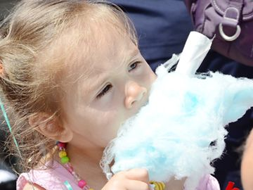 Margaretta Szabo, 3, of King City enjoys some cotton candy at the King City Festival June 15.
