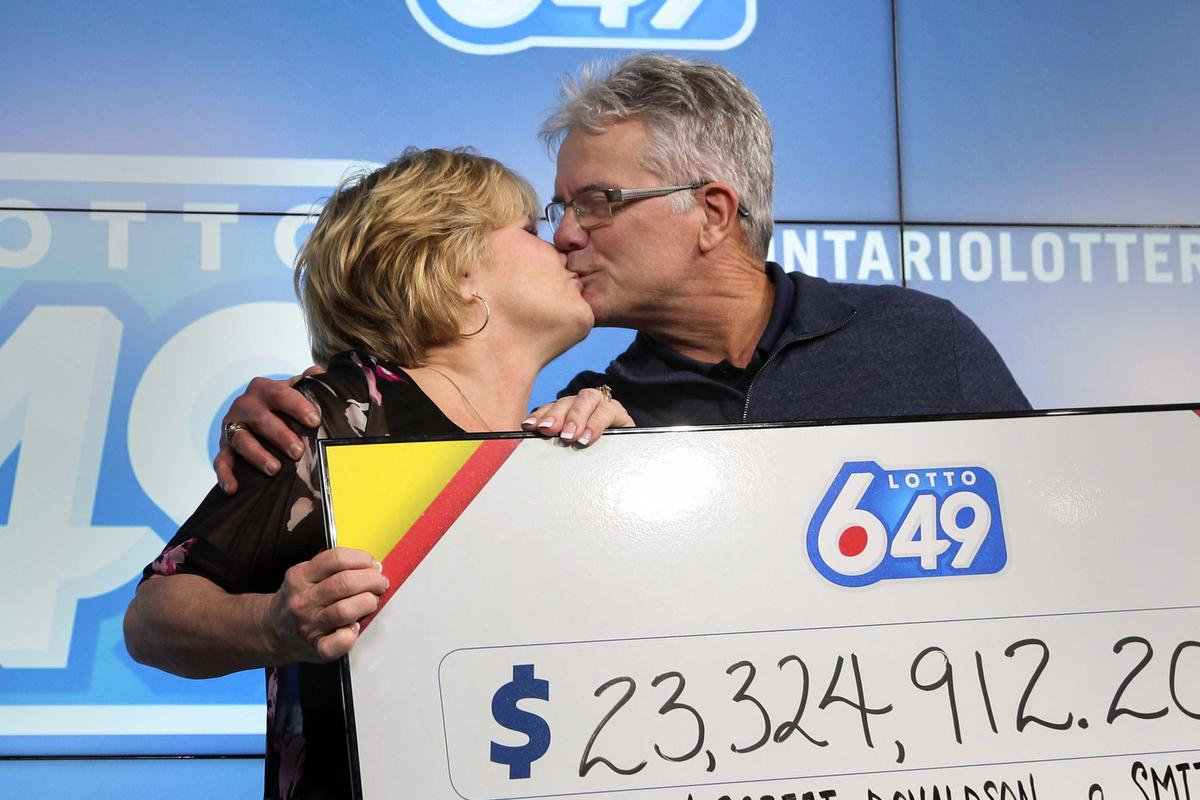 Smithville couple collect $23 million Lotto prize