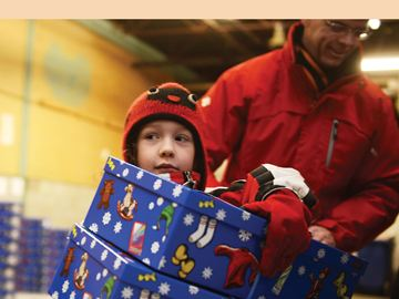 AJAX -- Jenny Fidler, 7, carried out Santa Boxes from The Toronto Star Santa Fund to be distributed before Christmas to needy families in Ajax and Pickering. November 30, 2013