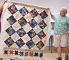 Donna Carnrite and an almost finished quilt