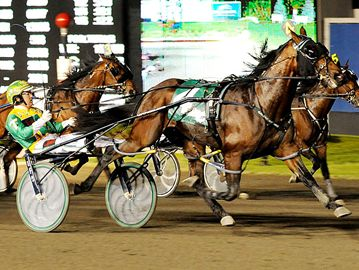 Here, Tim Tetrick driving #4 Captaintreacherous  crosses the finish line ahead of Twilight Bonfire driven by  Dave Miller.This was Tim Tetrick's first N/A Cup win.