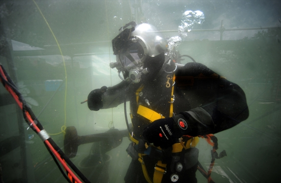 Underwater construction workers demonstrate in victoria