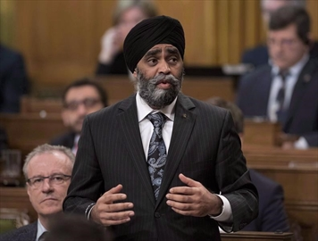 Minister of National Defence Harjit Sajjan rises during Question Period in the House of Commons on Parliament Hill, Friday, April 7, 2017 in Ottawa. Defence Minister Harjit Sajjan says he is truly sorry after claiming in a recent speech to have been the architect of Canada's largest battle in Afghanistan. THE CANADIAN PRESS/Justin Tang