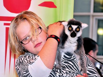 BOWMANVILLE -- A natue-themed Winter Wonder Learn took place at the main branch of the Clarington Library for Family Day. A visit by animals from the Jungle Cat World was included. Nine-year-old Mckenzie Doucetter looked a little hesitant as a ring-tailed lemur sat on her shoulder. February 17,2014