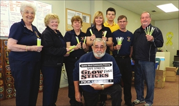 Community Police give out glow sticks– Image 1