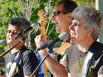 The annual Markham Village Music Festival was held Friday night and all day Saturday on Main Street. Members of Overunder belt out a rock standard for an appreciating crowd.