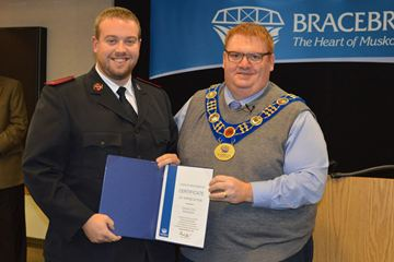THANKS: Captain Fred Reid from the Salvation Army receives a certificate of thanks from Mayor Graydon Smith to recognize his help during the flood in April 2013. (Photo by Jennifer Bowman)