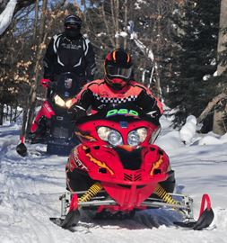 Some snowmobile trails have been closed in the region by a protest over a proposed bill.