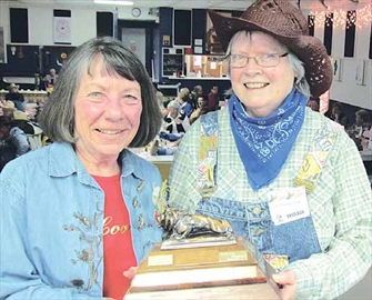 Shelagh Pool of the Arnprior Lionettes presents the Travel Lionette Award for the 53rd annual Lionettes Rally in Arnprior Sunday. Stittsville Lionettes vice-president Diane Davidson, left, accepts the trophy after 82 per cent of her club's members attended.