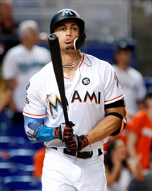 In this Thursday, Aug. 31, 2017 file photo, Miami Marlins' Giancarlo Stanton reacts after he flies out during the ninth inning of a baseball game against the Philadelphia Phillies in Miami. Giants general manager Bobby Evans confirmed on San Francisco's flagship radio station KNBR that the club has reached the parameters of a trade for Miami slugger Giancarlo Stanton. Evans spoke Wednesday, Dec. 6, 2017 of the Giants' pursuit of the Marlins star. (AP Photo/Wilfredo Lee, File)