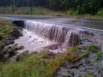 Area flooding damages roadways