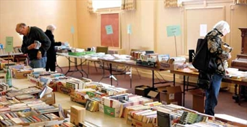 Shoppers look through hundreds of books at the Rideau Park United Church's Spring Nearly New Book Sale on April 12. The sale included clothes, household items as well as vintage books. Proceeds from the sale go to the church.
