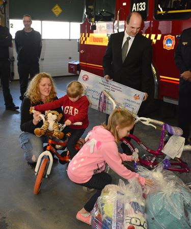 Toronto Firefighters donation to homeless family