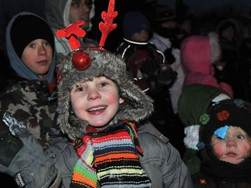 PORT PERRY -- Jack Yeo was all smiles as he watched the parade go by while waiting for Santa. After a snowy start, the skies cleared for the annual Port Perry Lions and Scugog Chamber of Commerce 'Christmas Around the World' Santa Claus parade on Saturday, November 23, 2013