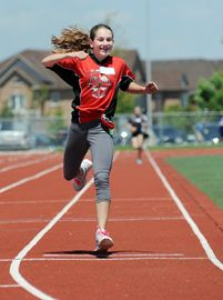 St. Raphael Elementary School athlete Evelyn O'Hara gives a fist pump as she crosses the finish line to win the grade 8, 800 metre race at the Catholic Elementary Schools track meet Wednesday at St. Marcellinus.