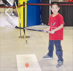 Kyle Van Kralingen, 6, from Barrhaven, takes a break from shooting pucks at one of the Ottawa Senator's activity stations at Hockeyfest on Nov. 24 at the Ernst and Young Centre. The two-day event was held for the first time this year and featured games, vendors, and speakers.