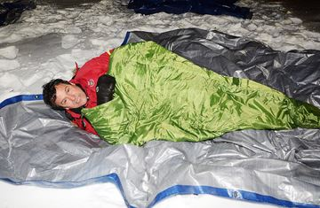 Shivering in sleeping bag in snow