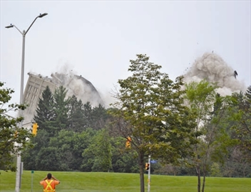 Blasting away the past; Sir John Carling building comes down in impres– Image 1