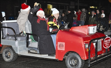 Community - Sophia and Bev Street braved the cold Nov. 23 for the annual Smiths Falls Santa Claus Parade. This year the parade switched to an evening event and dozens lined the streets for a glimpse of the brightly-lit floats.