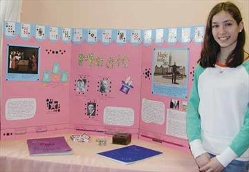 Ellie Zamorano stands with her display about magic which was the topic for her grade eight project presentation at the Ottawa Waldorf School in Stittsville on Wednesday, Feb. 26.