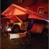 Man charged after car crashes into home
