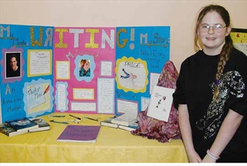 Pamela Whitlock is with her display about writing which was the topic for her grade eight project presentation at the Ottawa Waldorf School in Stittsville on Wednesday, Feb. 26.