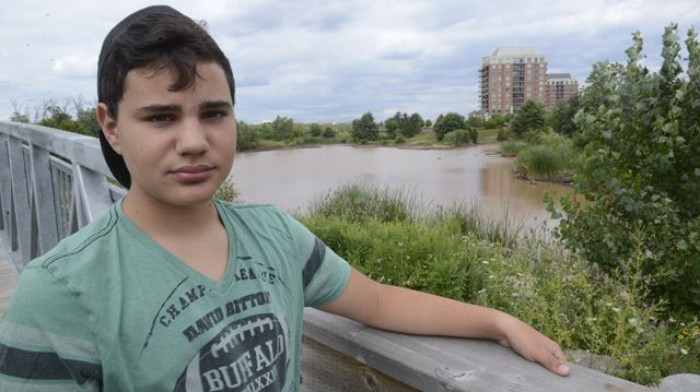 Oakville boy jumps to the rescue as stormwater pond dredged