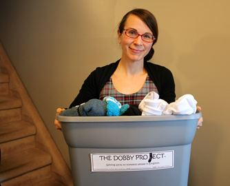Jennifer Anderson with some of her most recent sock donations.