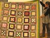Alice Williams and a nine-patch quilt