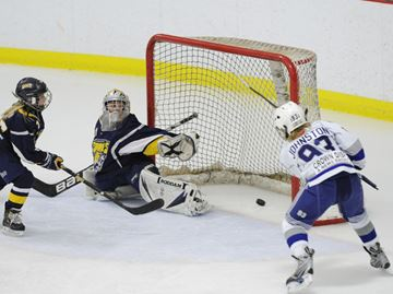 Here, Winterhawks Luke Johnston blasts a shot past Sabres goalie D.J. Parzen for Milton's first goal.