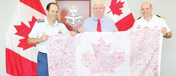 Carleton Place councillor presents signed flag to Canadian Forces gene– Image 1
