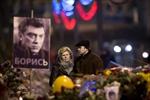 Woman with slain Putin critic says she didn't see his killer-Image1
