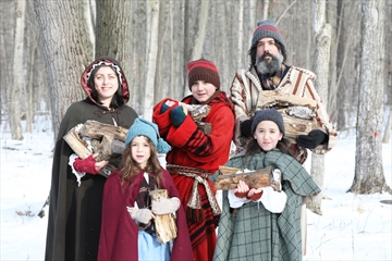 Joanne Alfonsi (left), Priya Laquintana, Matteo Laquintana, Marion Laquintana and Chiaro Laquintana get ready to welcome visitors to Westfield Heritage Village's annual Maple Syrup Festival.