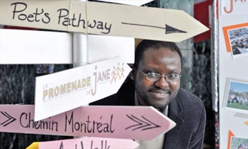 Lionel Njeukam of Jane's Walk Ottawa works at the event's booth as part of Heritage Day at city hall on Feb. 18. The annual festival of free neighbourhood walking tours on May 3 and 4 was one of the local events and institutions on display.
