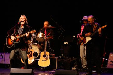 Musician Sean Connon, left, belts out a rock 'n' roll song during Northern Blues Review 12 at a packed Algonquin Theatre on Oct. 18. Musicians from across Muskoka performed in the popular charity concert, with funds raised supporting Princess Margaret Hospital.