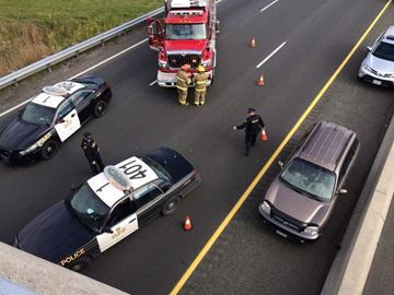 Woman falls from bridge onto Hwy 401