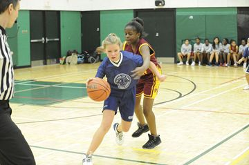 The Toronto Catholic District School Board held its Divisional Basketball Tournament on Friday at Don Bosco Catholic School. In this game a player from Our Lady of Peace (blue) wheels her way around a St. Dorothy's player on her way to the basket. St. Dorothy's won the game by a score of 35 to 12. (Feb. 22, 2013)