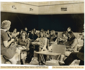 Teachers Hilda Birkett and Albert Willms discuss a trip with students in 1972.