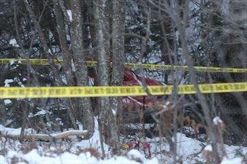 Hydro One that crashed csan be seen near Tweed, Ont., on Dec. 14, 2017. Ontario's largest electricity provider has released the names its four employees who were killed in a helicopter crash in eastern Ontario on Thursday. THE CANADIAN PRESS/Lars Hagberg