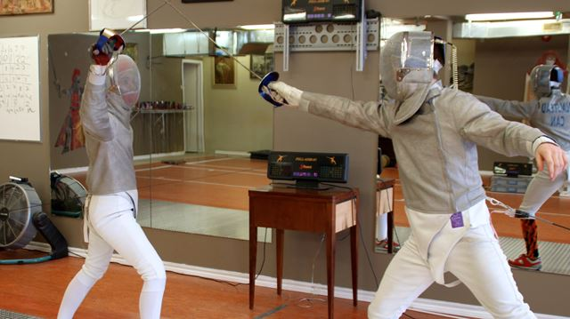 Fencers Megan Gorczyca-Rancourt (left) and Aaron Olmstead battle it out during a match.